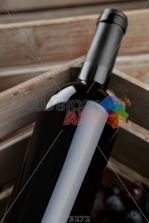 stock-photo-white-wine-bottle-close-up-in-wooden-crate-673272.png